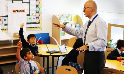 An image of Valrani interacting with his students during the Junior MBA program in Dubai.