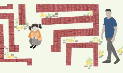 In this picture is an illustration of a maze, at the centre of which a child is sitting with her knees close and as if upset. Outside the maze is an adult walking towards it.