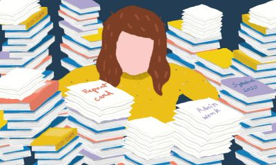 All illustration of a teacher overwhelmed by reports symbolizing pending work