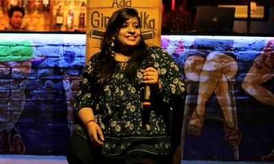 Sweta Mantrii, a female comedian sitting in a chair with a mic.