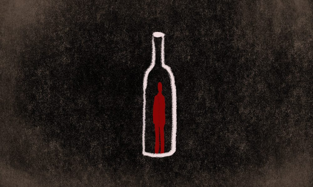 A red figure trapped inside an alcohol bottle