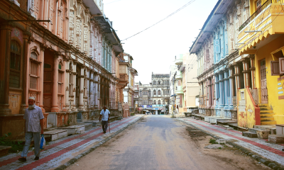 Two men walk on an empty street in India
