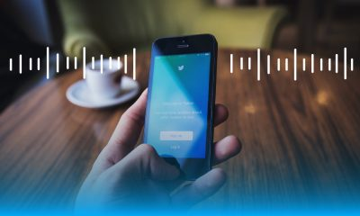 Image of a person holding a phone with Twitter on it