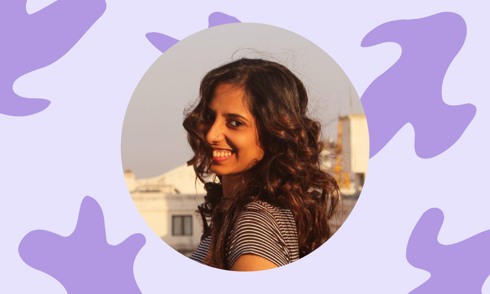 An image of Shreya Giria with a patterned purple background.