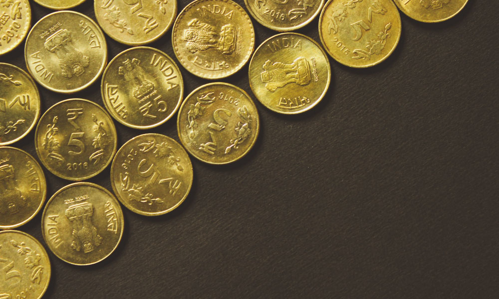 Indian rupee coins covered in gold.