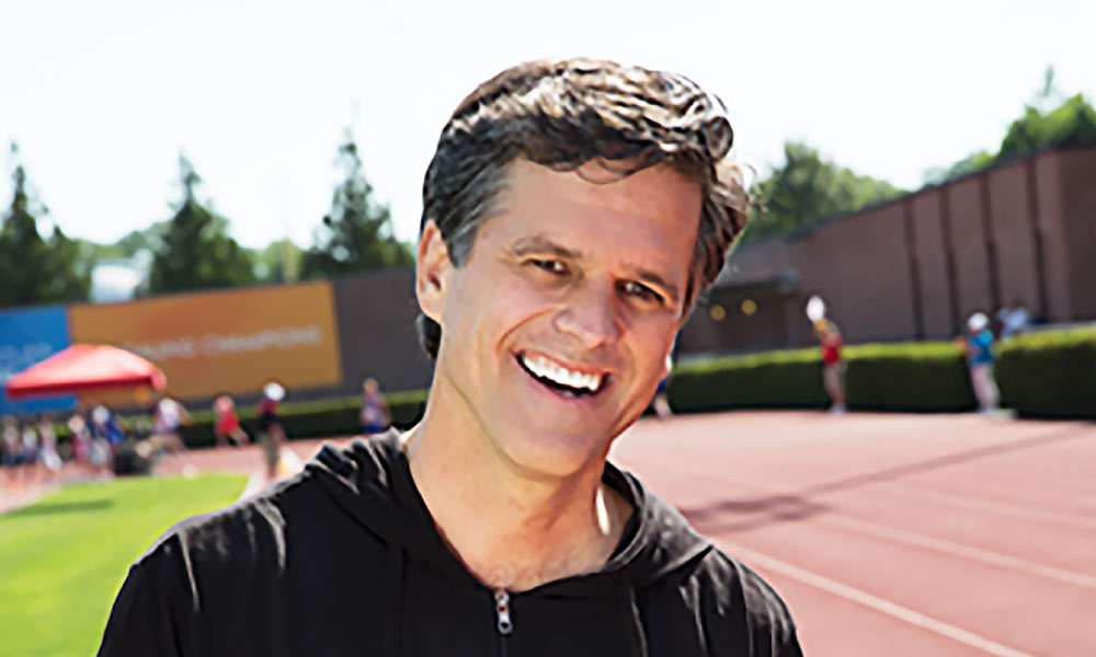a photo of special olympics chairman Timothy Shriver smiling