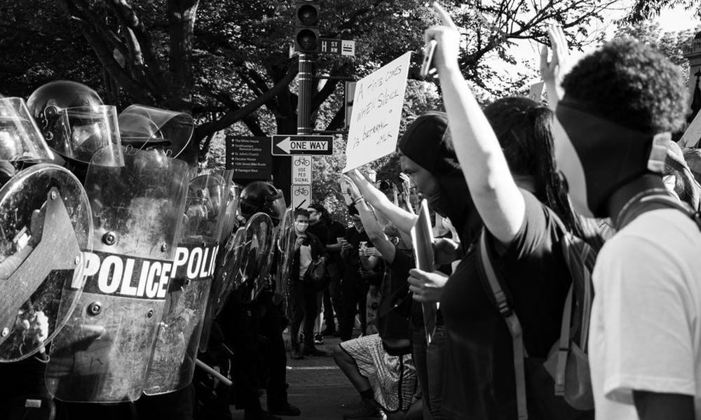 Protesters of the black lives matter movement opposite police