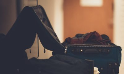 a side shot of a suitcase with clothes filled in