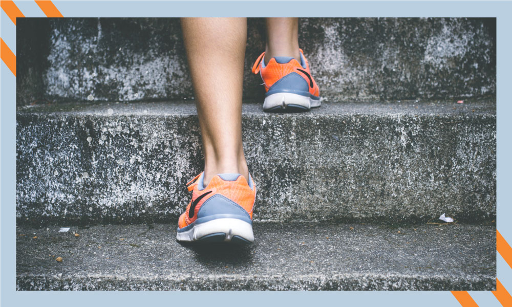 Image of a person walking up stairs.