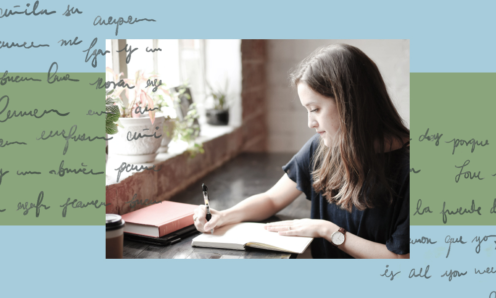 An image of a girl journaling with a blue background with handwriting on it.