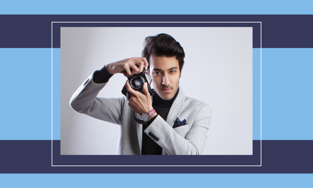 Image of photographer Nasser Ali posing with his camera