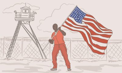 Illustration of Black prisoner in prison uniform holding the American flag