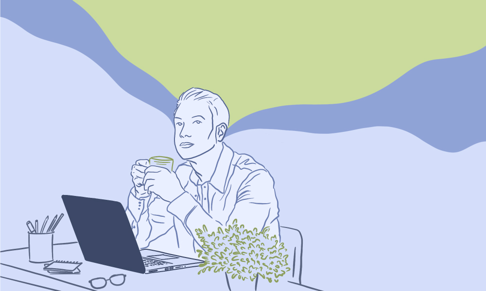A man daydreaming while he is sitting on his work from home desk.