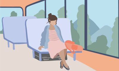 An illustration of a woman travelling in a bus, there is a bag next to her and a suitcase under her seat.