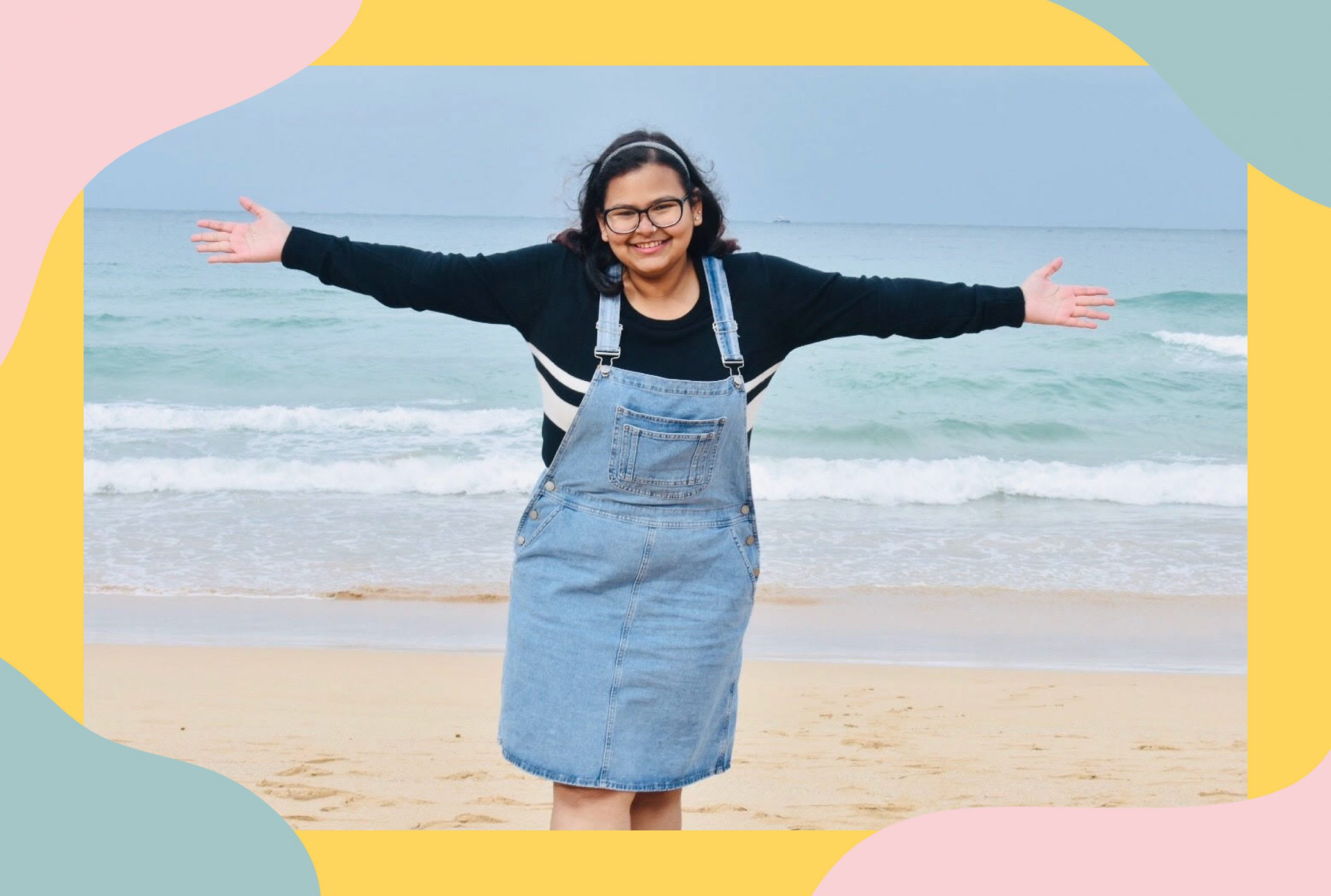 An image of Soumya Mishra wearing blue overalls and a dark full sleeve sweater.