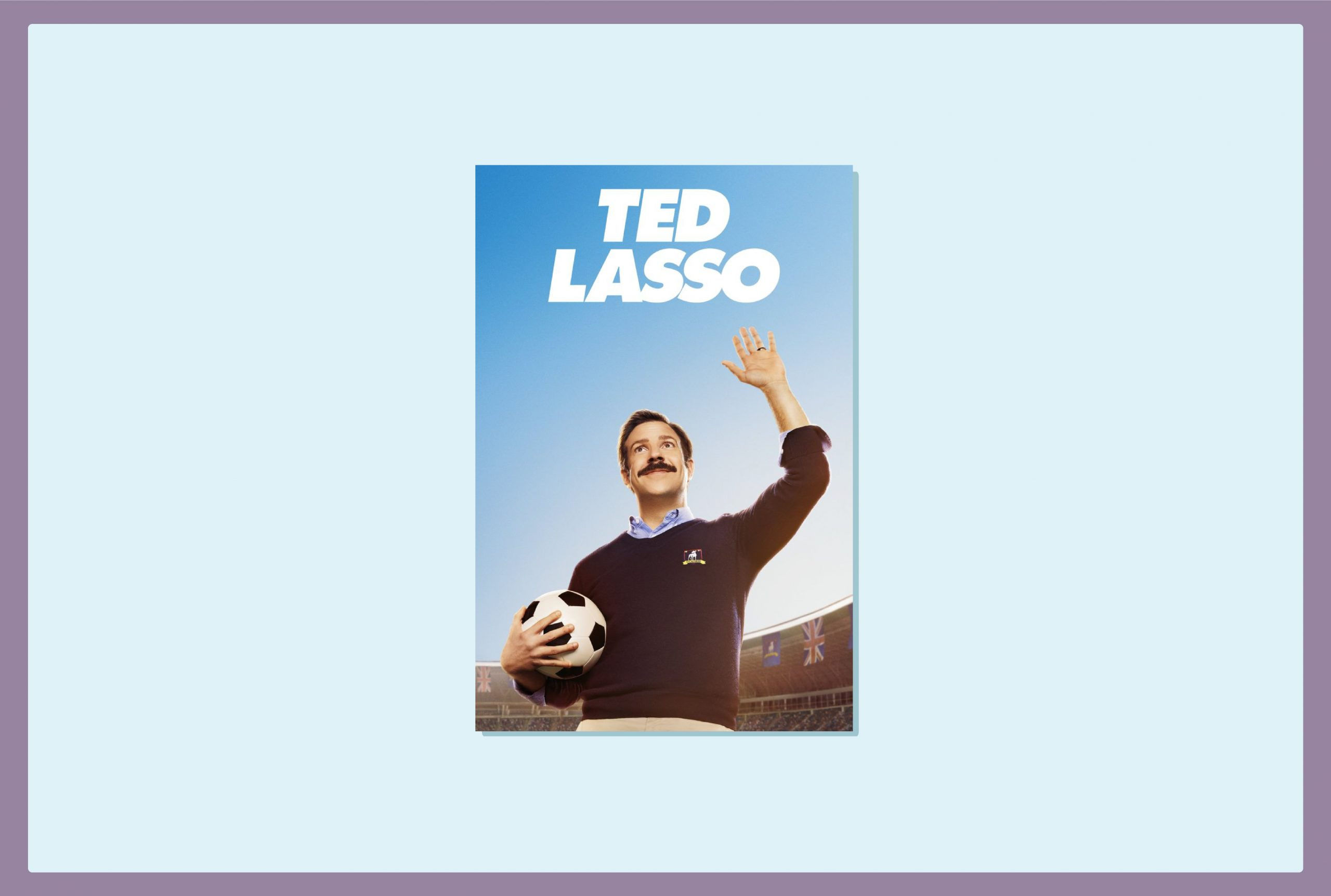 A white, moustachioed man holds a football in his right hand and his left hand is lifted into a fist indicating victory. Above him reads the title 'Ted Lasso'