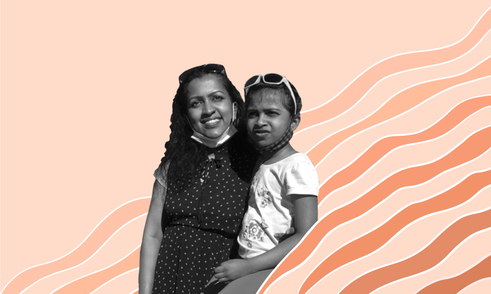 An image of Dhanya Sasidharan with her daughter.