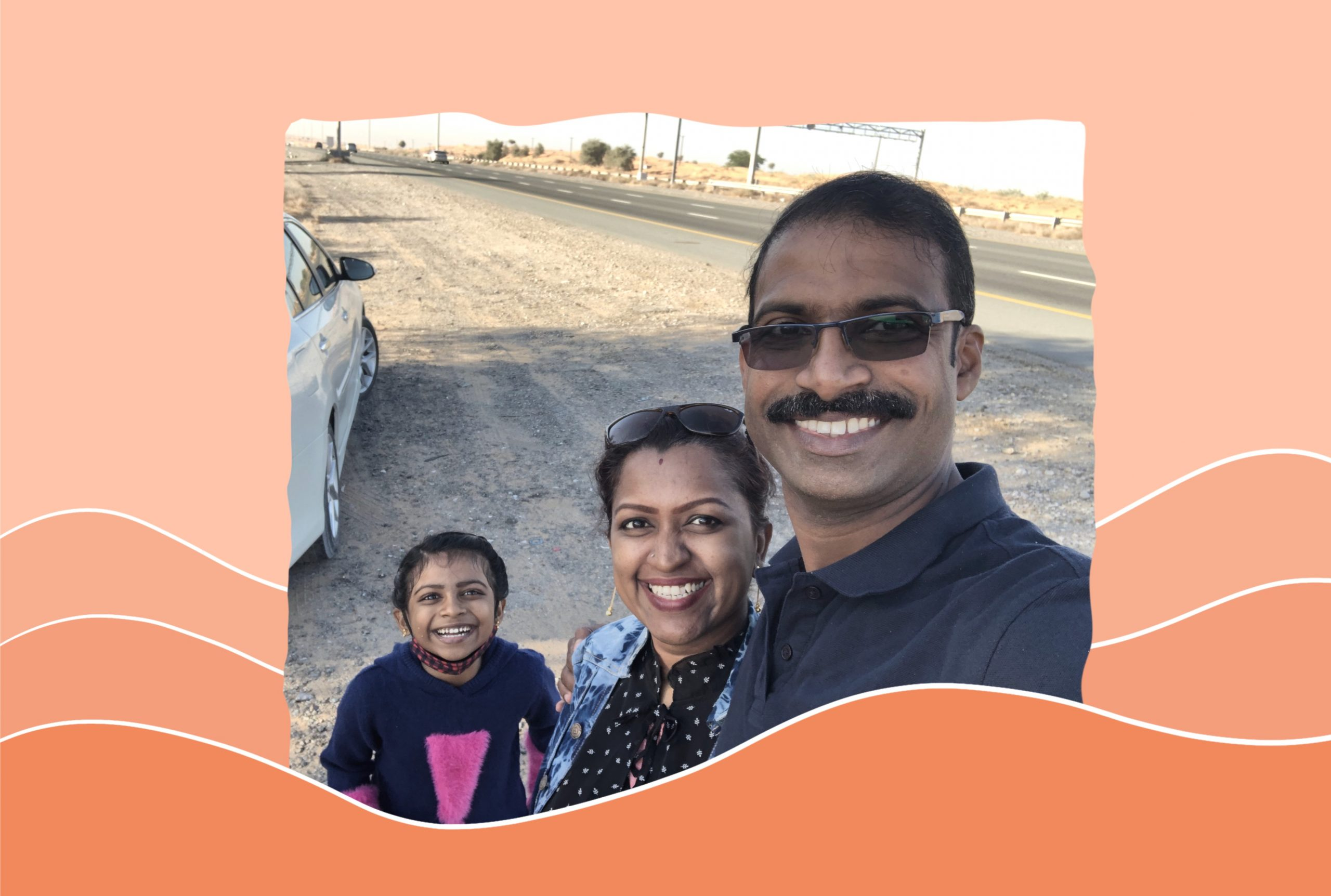 An image of Dhanya Sasidharan with her husband and her daughter.