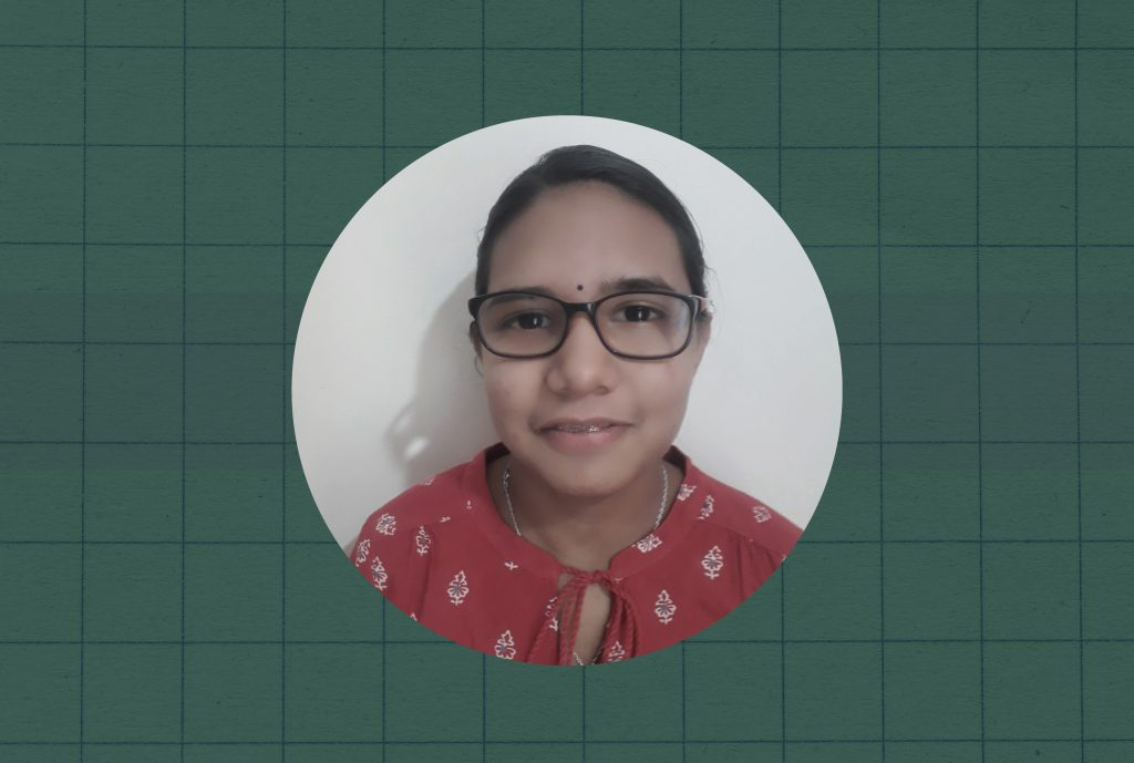 A close up portrait of Mallavikha, a NIOS student, against a green checkered background.