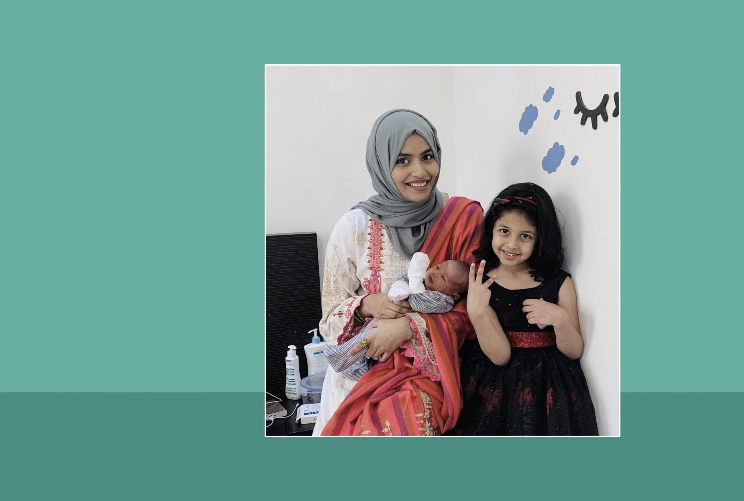 Image of Nusreen Moideen with her daughter and son