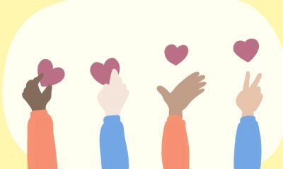 An illustration of 4 people's hands with hearts around it