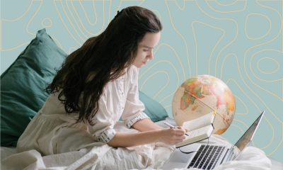 A woman working from home wearing pyjamas.