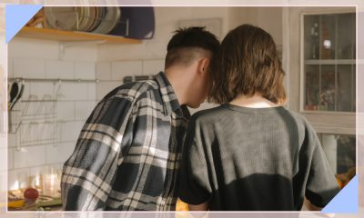 An image of a couple from behind looking over a counter.