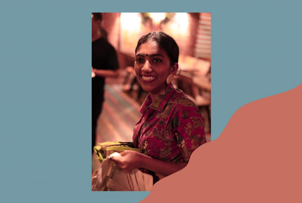 an image of the author Vaishnavi Suresh smiling against a teal and pink background