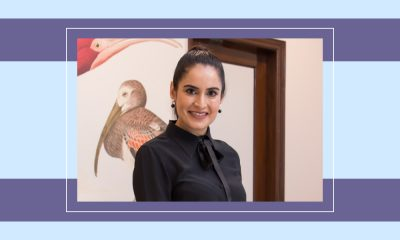 An image of dermatologist Dr. Kiran Sethi with an illustrated purple background and frame around her