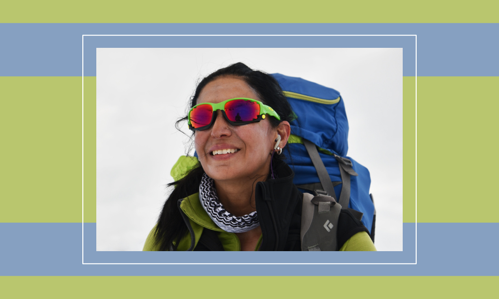 Photo of Suzanne Al Houby smiling in her mountain climbing gear