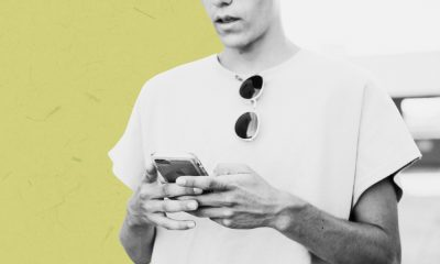 The image of a a man worriedly checking his phone.