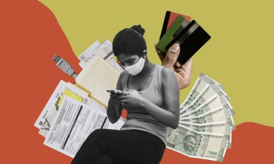 a collage of a woman with a mask on looking at her phone and behind her are pictures of indian money, credit cards, documents, a usb against a red and yellow background