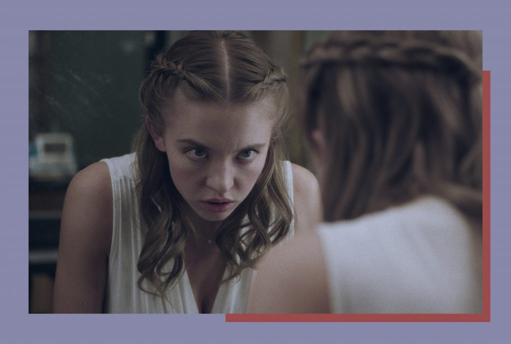 a still of actor Sydney Sweeney in Nocturne glaring into the mirror