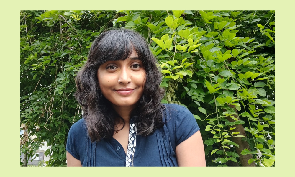 An image of young climate change activist Disha Ravi set against a green background