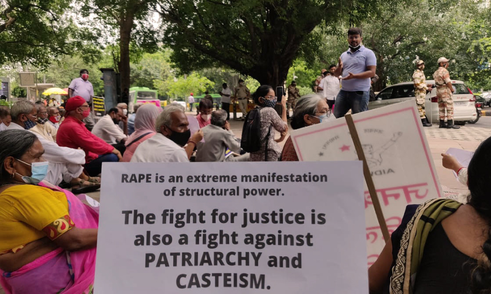 """Image showing a banner, that reads """"The fight for justice is also a fight against Patriarchy and Casteism', of protest at rally by the Students' Federation of India in Delhi, against the rape and murder of a 9 year old Dalit girl."""