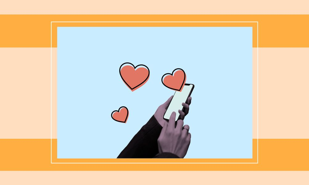 Image of a hand swiping on a phone with three hearts above the phone.